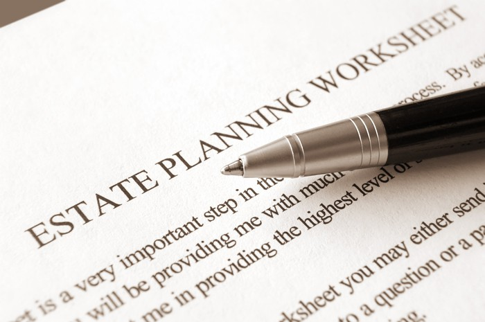 Estate planning worksheet with a pen on top.
