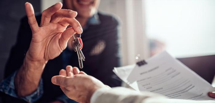 Real estate agent handing keys over