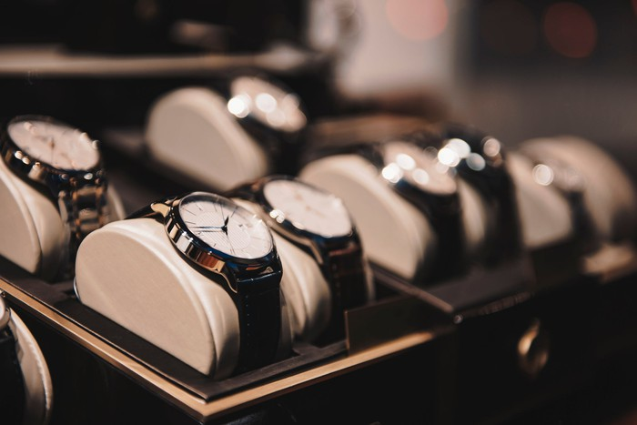 A row of watches in a retail store.