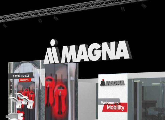 The Magna logo above a display at the 2019 International Auto Show in Frankfurt, Germany.