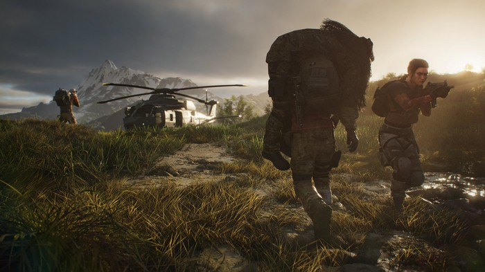 A soldier character carrying another character towards a helicopter in Ghost Recon: Breakpoint.