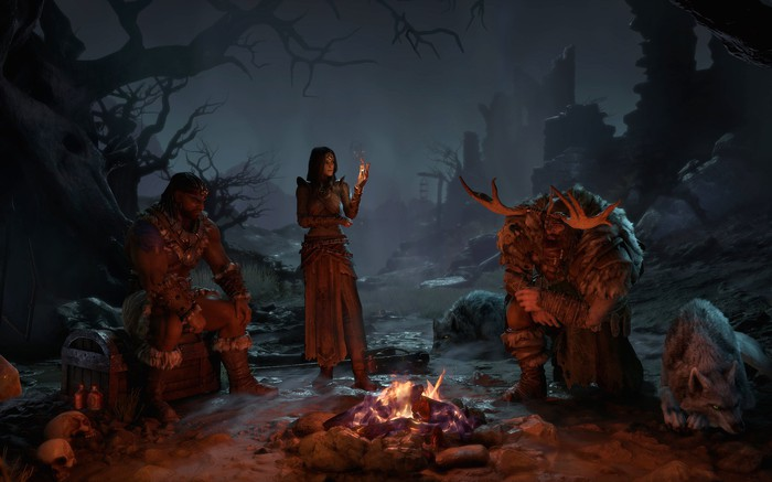 A screenshot of Diablo 4 with in-game characters in a dark wooded area standing around a camp fire.