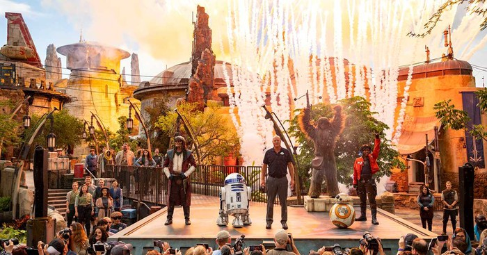 Costumed characters and park execs on stage during Disney World's opening of Star Wars: Galaxy's Edge.