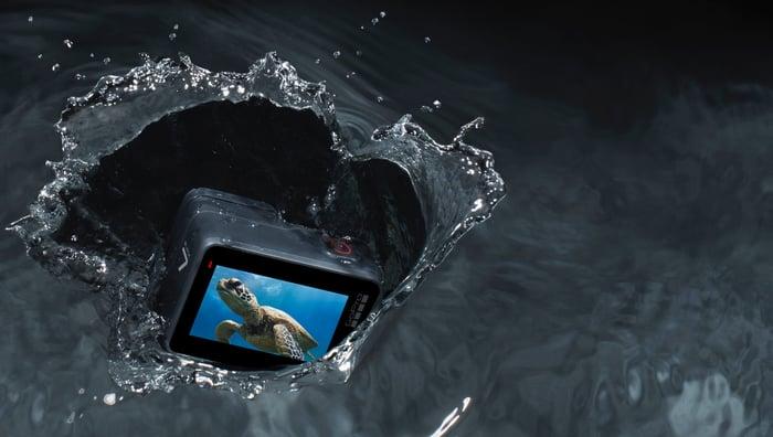 A Hero 8 Black camera drops into the water.