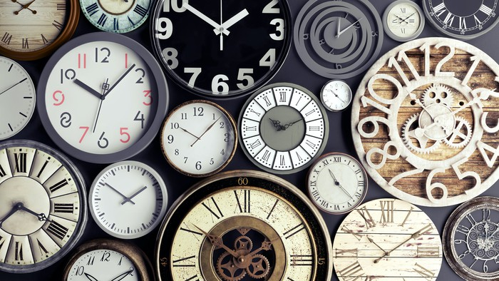 A multitude of wall clocks.