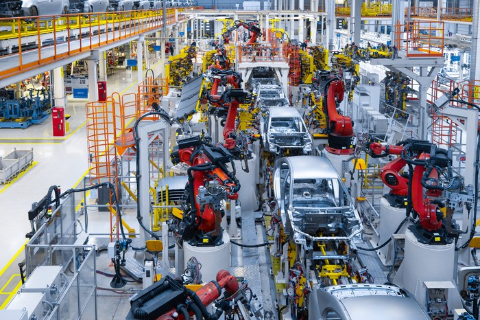 A factory floor featuring substantial robotics and automation.
