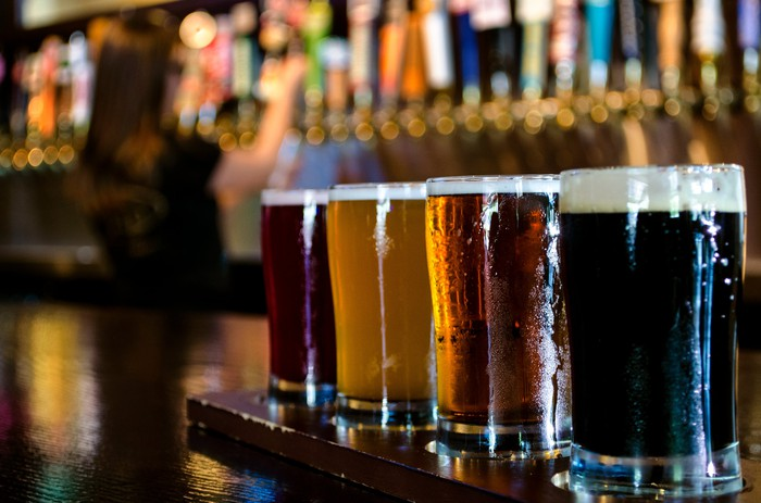 A flight of craft beers on a bar