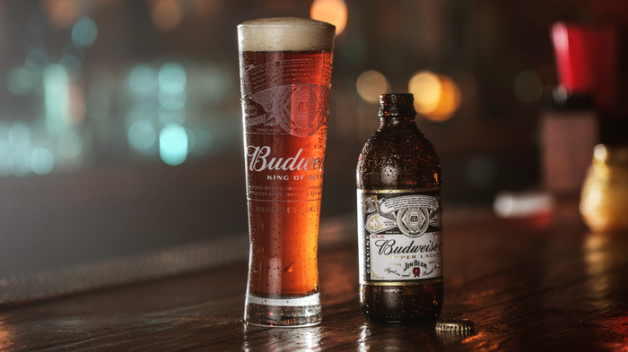 A glass and bottle of Budweiser