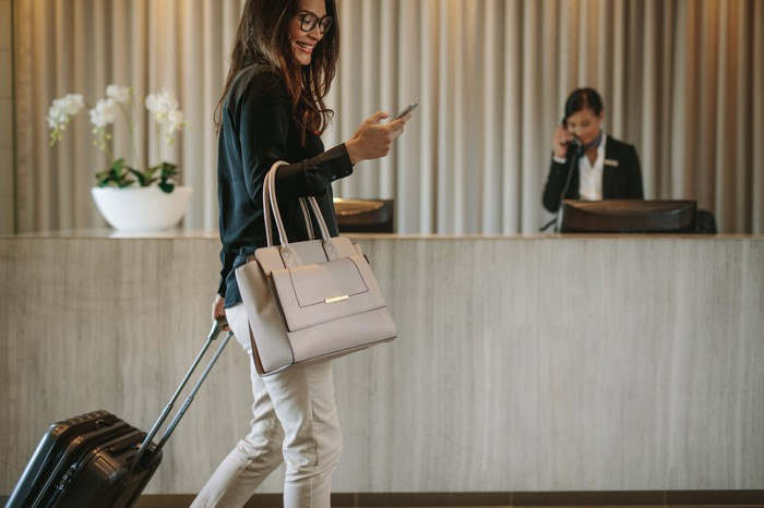 Woman checking into hotel.