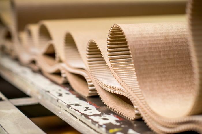 Corrugated cardboard folded into loops.