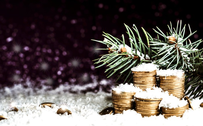 A pile of gold coins in the snow.