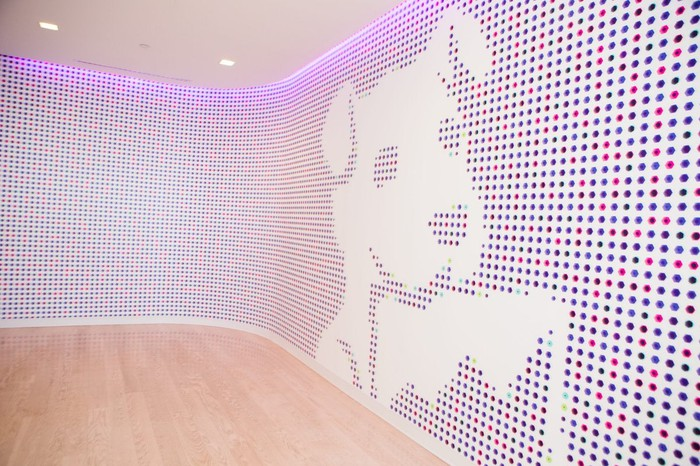 Mosaic wall at Datadog headquarters featuring the company's dog mascot.