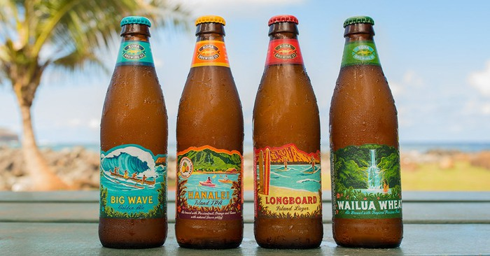 Four bottles of Kona Brewing beer.