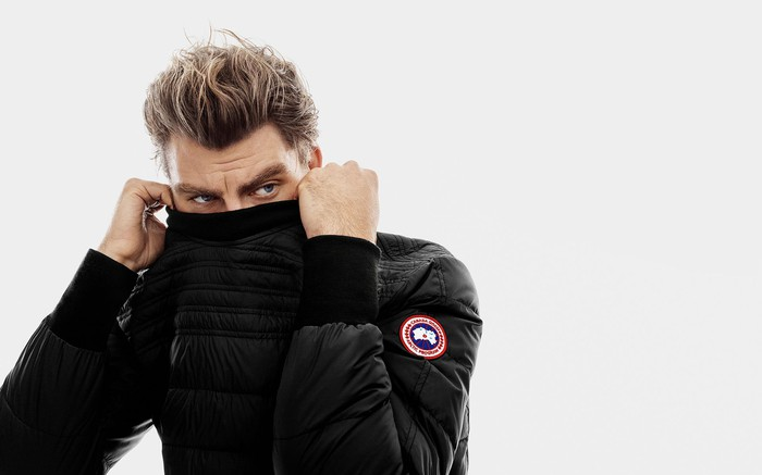 Person pulling Canada Goose jacket over his nose and mouth.