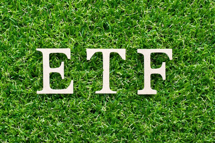 The letters ETF on a bed of green grass
