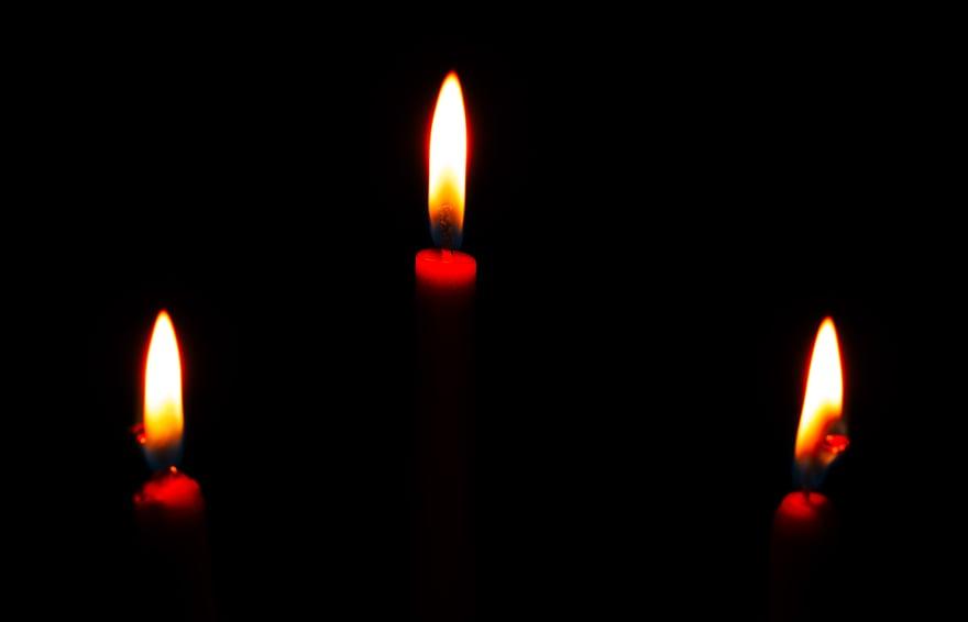 3 candles in dark