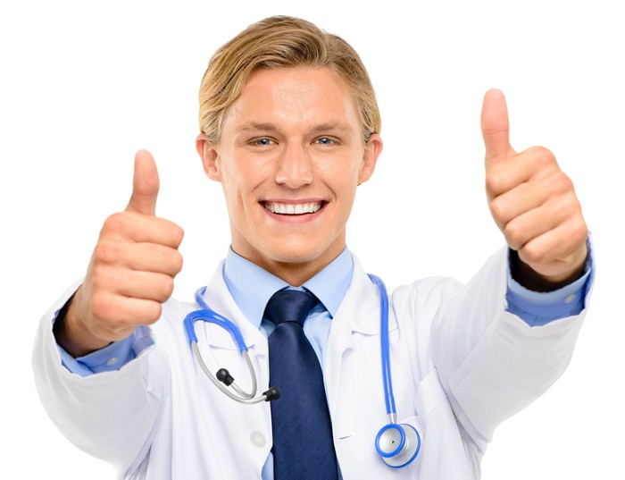 Doctor giving double thumbs up.