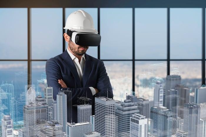Developer using virtual reality headset
