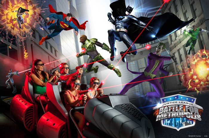 Guests riding the Battle for Metropolis laser-shooting dark ride at Six Flags with several DC Comics characters as concept art.