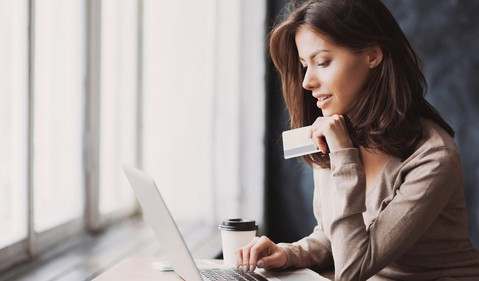 Woman shopping online with laptop and credit card