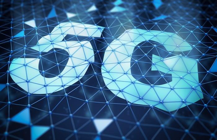 The word 5G written on a wavy web-like design