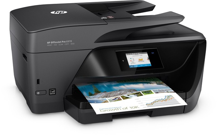 HP model printer in black, with printed page in the feeder.