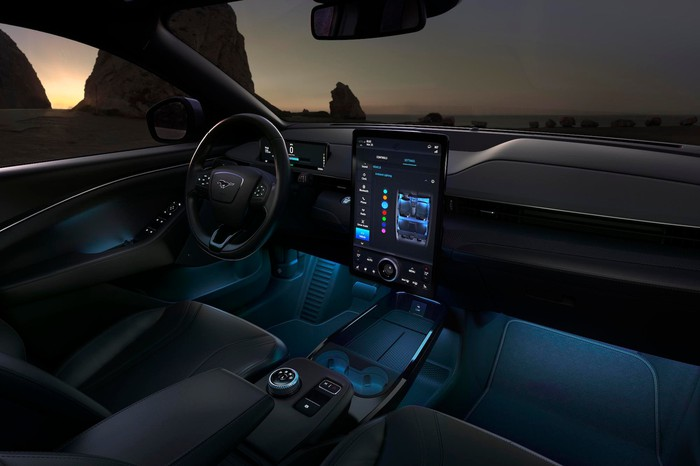 A view of the front seat and dashboard of a Mach-E, showing a large touchscreen in the center stack.
