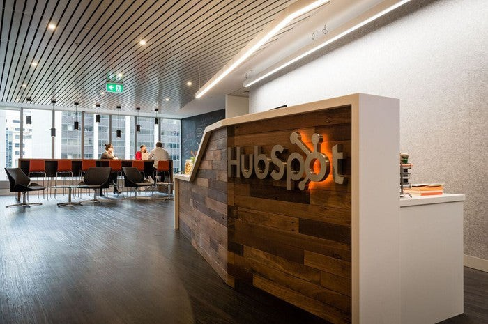 A reception desk that says Hubspot