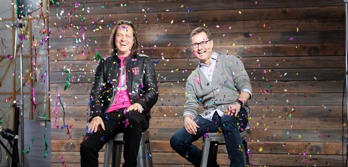 John Legere and Mike Sievert smiling with confetti