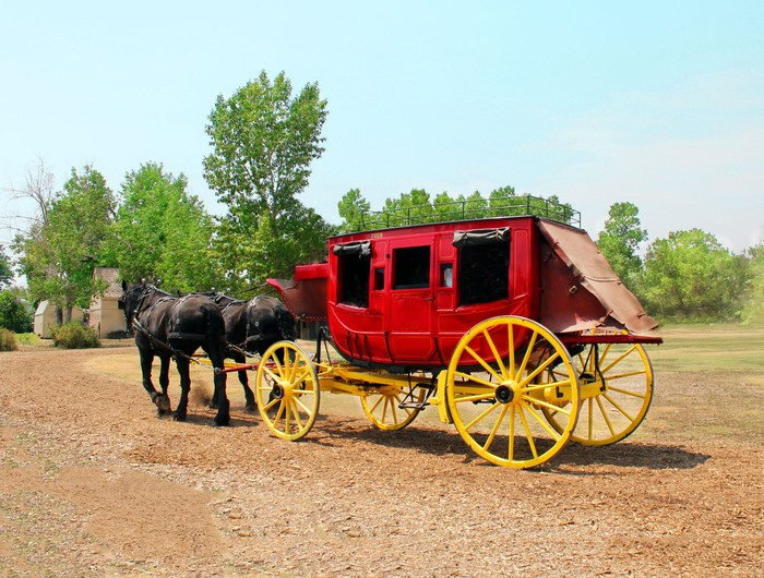 Red stagecoach with horses