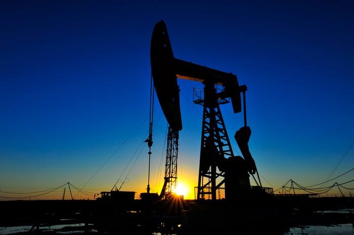 An oil pump at sunrise
