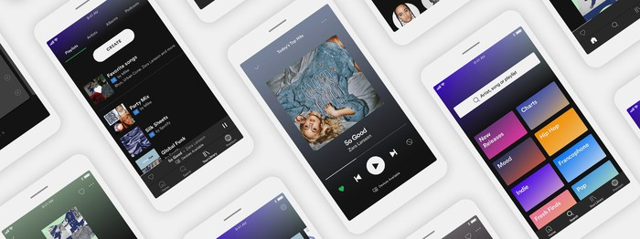 Several smartphones displaying the Spotify app.