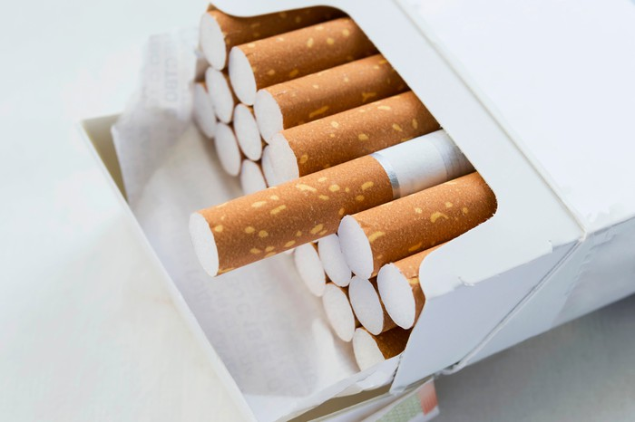 A pack of cigarettes with one poking out