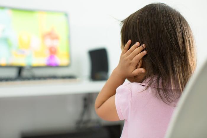 Toddler watching cartoons on TV.