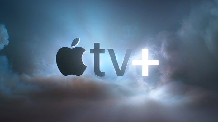 The Apple TV+ logo set against a cloudy sky.