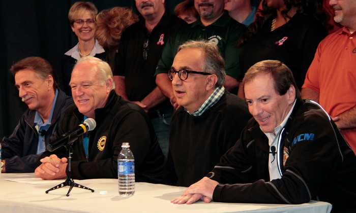 UAW officials Norwood Jewell and Dennis Williams are shown at a table with Marchionne and FCA employee-relations chief Glenn Shagena at an event to announce a new labor contract in 2015.