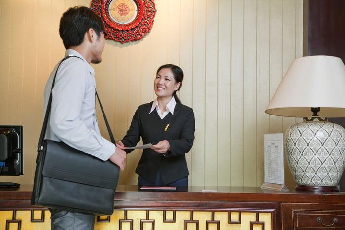 A businessman checks into a contemporary Chinese hotel.