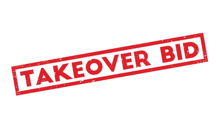 The words Takeover Bid in red letters on a rubber stamp.