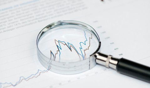 magnifying glass stock chart getty