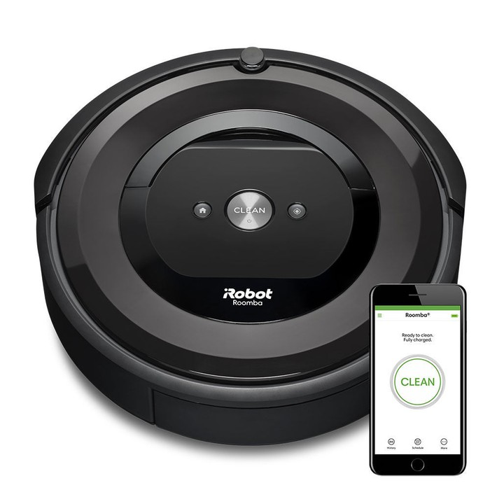 iRobot's Roomba E5 (5150) robotic vacuum cleaner next to the Roomba app displayed on a smartphone.