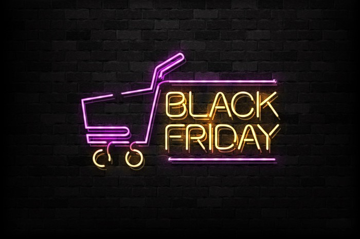 Neon lighting making a shopping cart and the text 'Black Friday.'