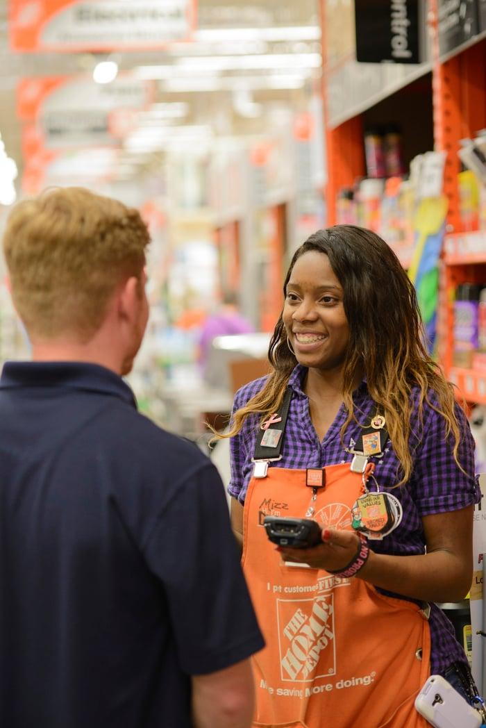 Home Depot employee helping a customer.