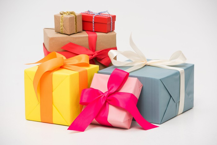 Pile of colorfully wrapped gifts in different sizes.