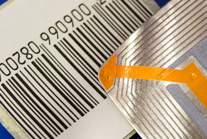 A close-up of an RFID chip and a barcode.