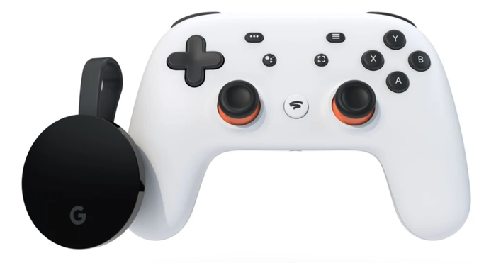 White and black Google Stadia gaming controller and Chromecast dongle.