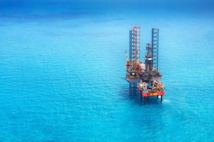 An offshore drilling rig in the open ocean.