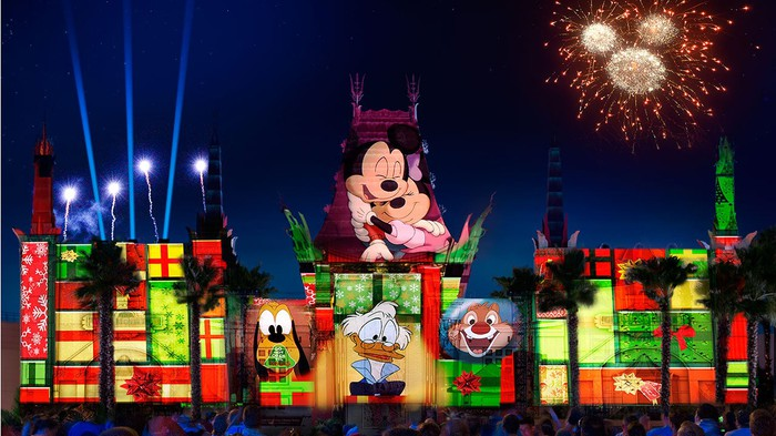 Scenes of classic Disney characters projected on buildings during a nighttime Disney's Hollywood Studios show.