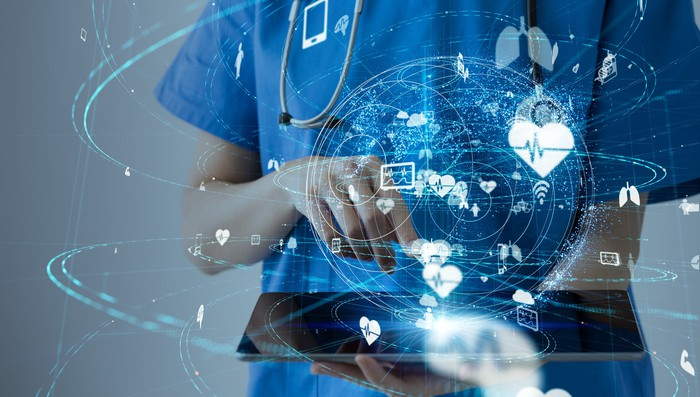 A healthcare worker holding a tablet. Abstract images related to healthcare and technology are overlaid on top.