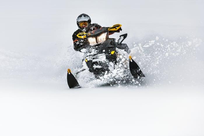 A person riding a snowmobile.