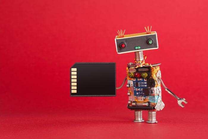 A robot holds an SD card.